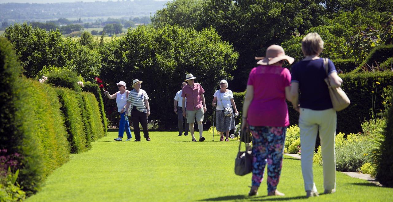 Elderly peopel walking in garden of hyde hall